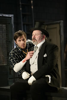 "Justin Hagan as George and Tom Riis Farrell as The Millionaire in Noah Haidle's ""Rag and Bones,"" Long Wharf Theatre"